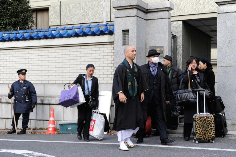<p>People leave the headquarters of the North Korean residents association in Japan, known as Chongryon, in Tokyo on December 28, 2011, the date of North Korean leader Kim Jong-Il's funeral. At its apex, Chongryon had hundreds of thousands of supporters in Japan.</p>