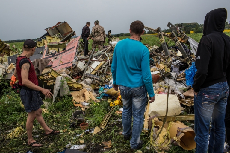 <p>Men search the wreckage of a commercial passenger plane that was shot by a missile on July 18, 2014 in Grabovka, Ukraine. Malaysia Airlines flight MH17 was traveling from Amsterdam to Kuala Lumpur.</p>