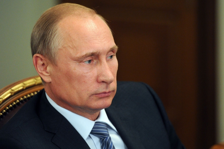 <p>Russia's President Vladimir Putin attends a meeting in his Novo-Ogaryovo residence outside Moscow, on July 29, 2014.</p>