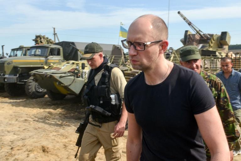 <p>Ukraine's Prime Minister Arseniy Yatsenyuk walks during a visit to the headquarters of Ukrainian forces near the Ukrainian city of Izyum, in Kharkiv region on July 16, 2014.</p>
