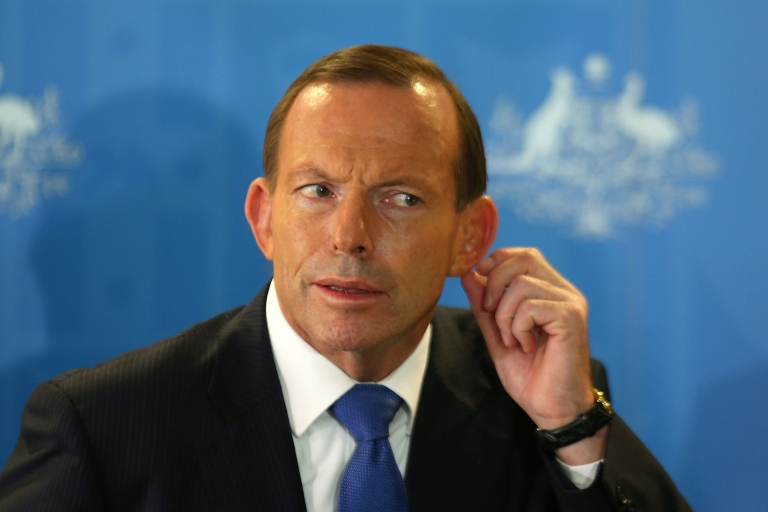 <p>Australian Prime Minister Tony Abbott listens to a question from a reporter during a press conference at RAAF base Pearce on March 31, 2014 in Perth, Australia.</p>
