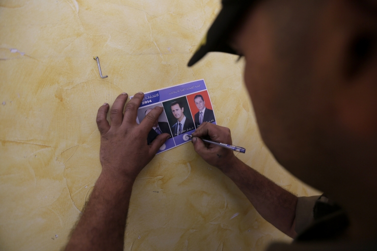 <p>A Syrian man votes in Homs.</p>