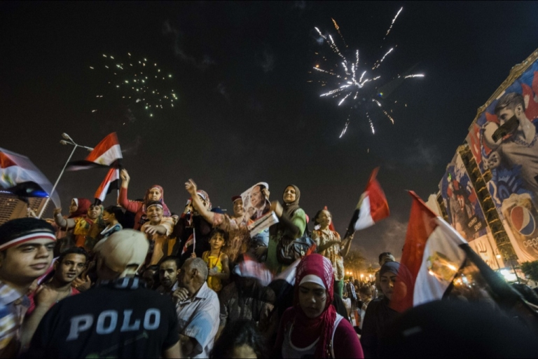 <p>Supporters of the new President Sisi celebrate in Cairo on June 3, 2014. After his inauguration less than a week later, seven men were arrested for sexually assaulting women during similar celebrations.</p>