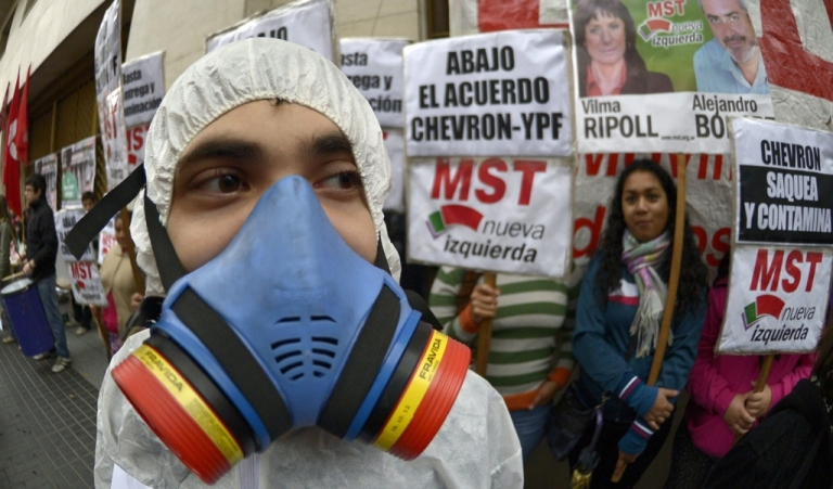 <p>Protesters rally in Buenos Aires against an agreement between Argentina's state-owned oil company YPF and Chevron.</p>