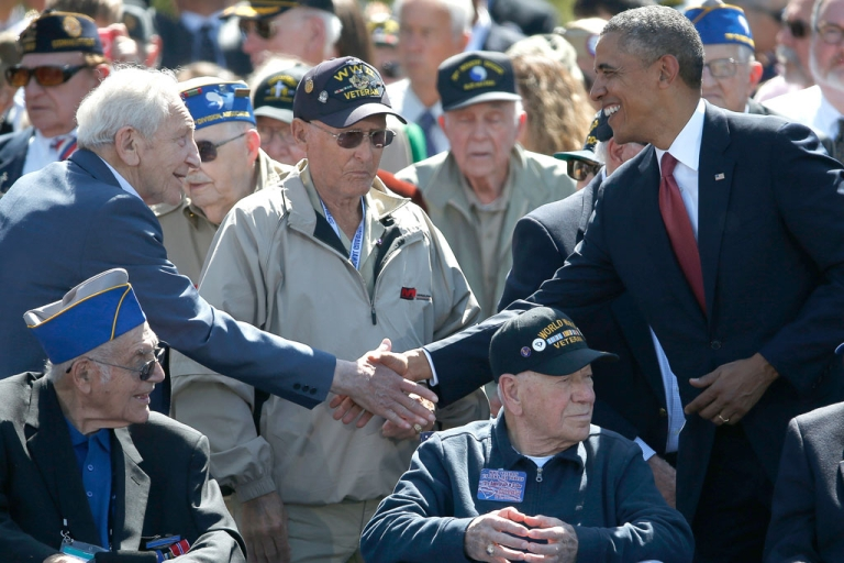 <p>US President Barack Obama greets World War II veterans during a ceremony at the Normandy American Cemetery on the 70th anniversary of D-Day June 6, 2014 in Colleville-sur-Mer, France.</p>