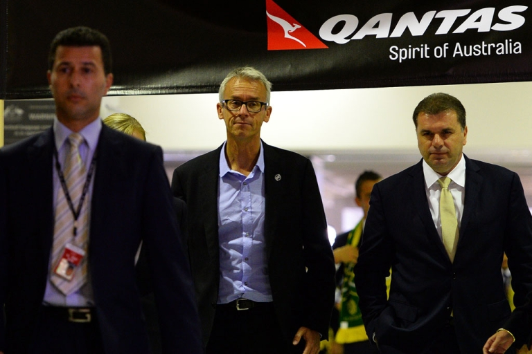 <p>Football Federation Australia chief executive David Gallop and Australian national football team's head coach Ange Postecoglou depart with the World Cup 2014 squad for Brazil on May 28, 2014.</p>