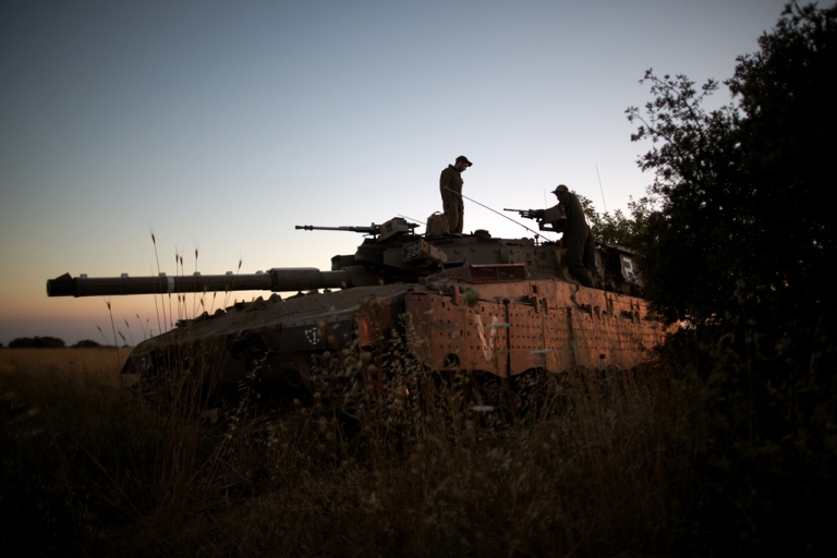 <p>Israeli soldiers positioned near the Quneitra checkpoint on the border with Syria in the Golan Heights, June 22, 2014.</p>