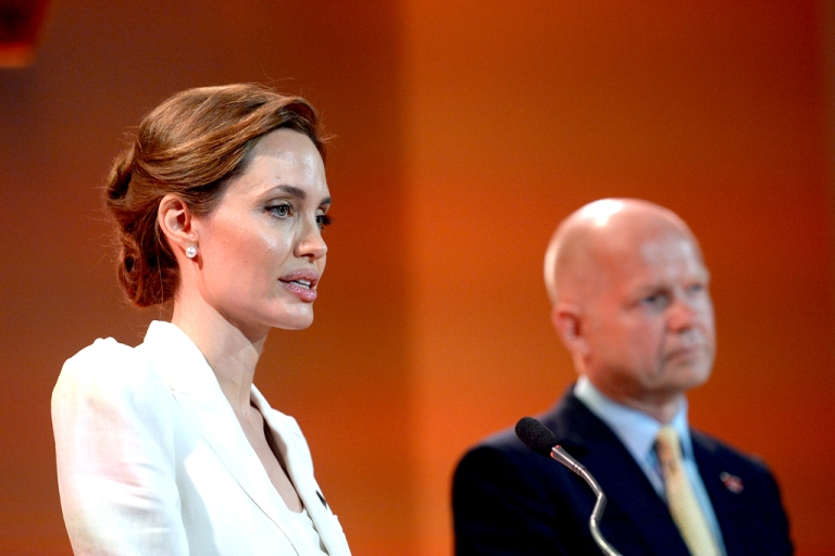<p>UN special envoy Angelina Jolie makes the opening speech with co-host Britain's Foreign Secretary William Hague at the start of the four-day Global Summit to End Sexual Violence in Conflict on June 10, 2014 in London, England.</p>