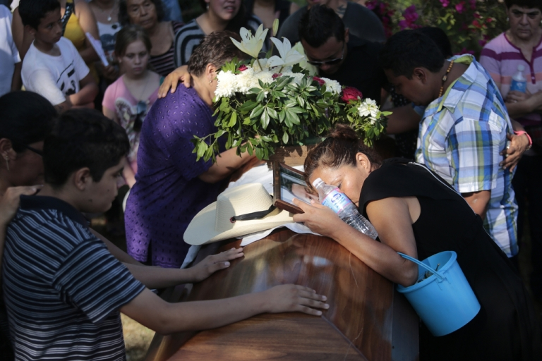 <p>Mourners attend the funeral of Mexican journalist Jorge Torres on June 3, 2014, near Acapulco in Guerrero. Torres was kidnapped and murdered late last month.</p>