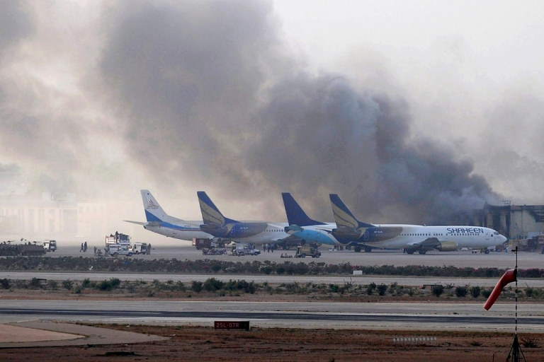<p>Smoke rises after militants launched an early morning assault at Jinnah International Airport in Karachi on June 9, 2014.</p>
