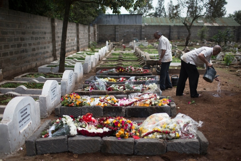 <p>A cemetery worker washes his hands next to 5 fresh graves after the funeral ceremony of Ruhila Adatia Sood, A Radio Africa television and radio presenter, on September 26, 2013 in Nairobi, Kenya. The country is observing three days of national mourning as security forces begin the task of clearing and securing the Westgate shopping mall following a four-day siege by militants.</p>
