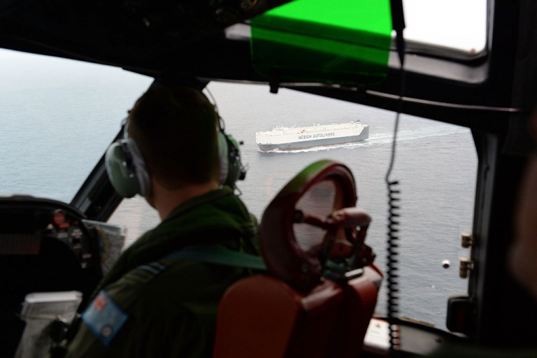 <p>The Norwegian merchant transport ship Hoegh St. Petersburg, which has been diverted to take part in the search, is seen from a Royal Australian Airforce AP-3C Orion from Pearce Airforce Base during a search mission for possible MH370 debris on March 21, 2014 in Perth, Australia.</p>