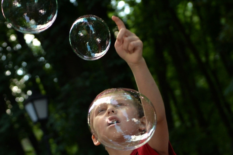 <p>A boy plays with soap bubbles during a charity event organized by a motorcycle club for children with autism in Kiev, Ukraine, on May 28, 2013.</p>