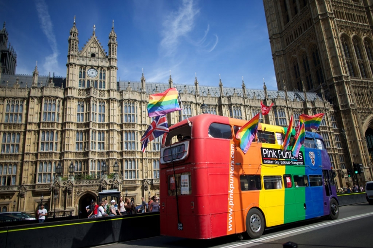<p>Gay campaigners drive a bus past the Houses of Parliament as the Marriage (Same Sex Couples) Bill gets an unopposed third reading by the Lords in central London on July 15, 2013.</p>