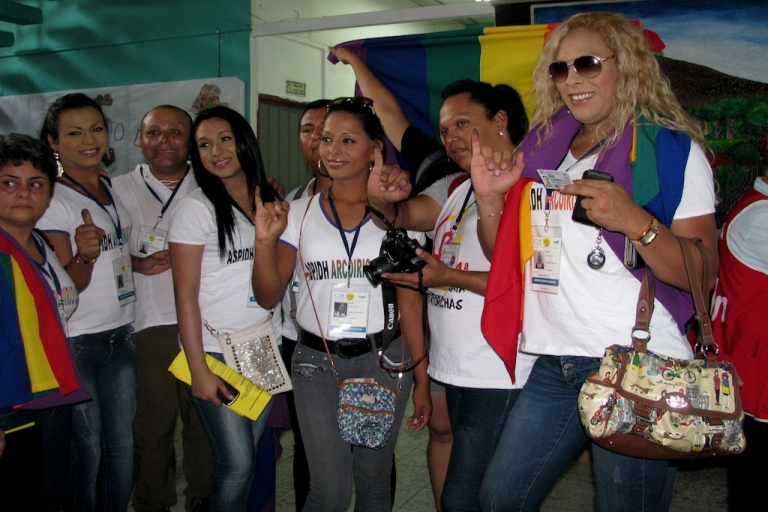 <p>LGBT activists display their inked fingers after voting in the second round of the Salvadoran presidential elections, on March 9, 2014. in order to prove that a citizen has voted, fingers are dipped in semi-permanent ink after turning in the ballot. Third from left is Pati Hernandez, executive director of ASPIDH Arco Iris, and second from right is Karla Avelar, executive director of COMCAVIS trans.</p>