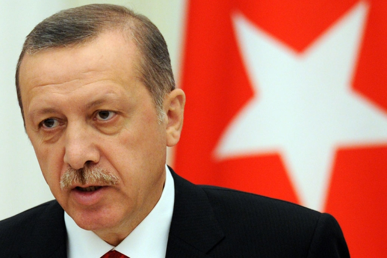<p>Turkish Prime Minister Recep Tayyip Erdogan speaks during a press conference after their meeting to discuss differences on Syria as UN Security Council prepared to vote on the conflict with Russian President Vladimir Putin in Moscow's Kremlin on July 18, 2012.</p>