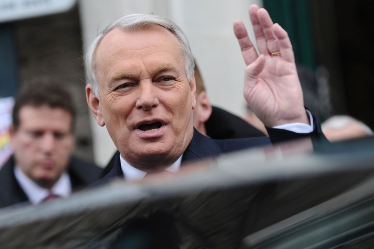 <p>French Prime Minister and former Nantes mayor, Jean-Marc Ayrault, leaves a polling station after voting in the second round of the French municipal elections on March 30, 2014 in Nantes, western France.</p>