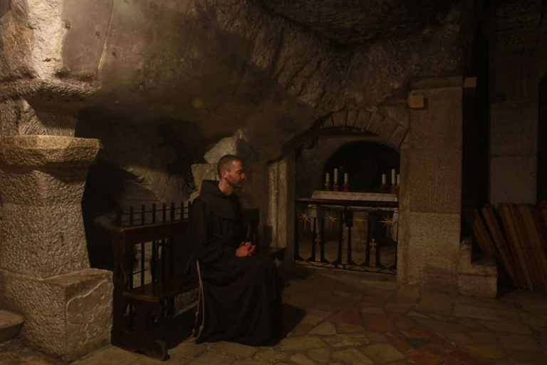 <p>A Franciscan monk prays inside the cave at the Church of the Nativity in the biblical West Bank city of Bethlehem, Dec. 24, 2012.</p>