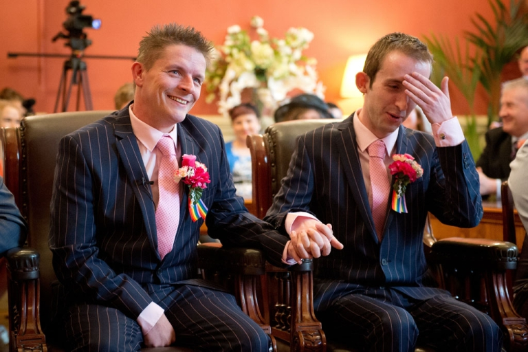 <p>Phil Robathan (left) and James Preston (right) during their wedding ceremony in Brighton, southern England, March 29, 2014.</p>