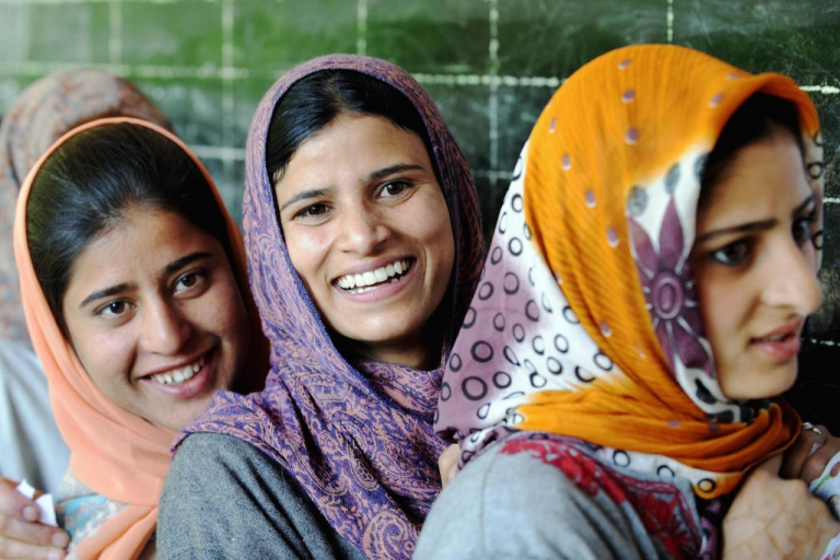 <p>Young Kashmiri women wait for their turn to vote in India's elections, in May 2009. When India goes to the polls next month, young voters will be a powerful force.</p>