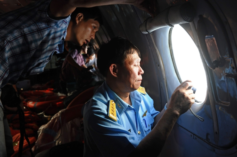 <p>This picture taken from aboard a flying Soviet-made AN-26 used as a search aircraft by Vietnamese Air Force to look for missing Malaysia Airlines flight MH370, March 9, 2014.</p>
