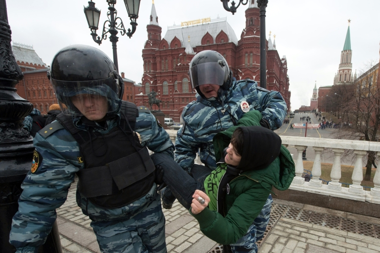 <p>Russian police detain an anti-war protester near the Kremlin during on Sunday.</p>