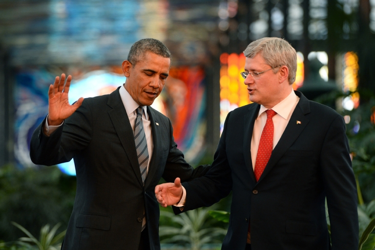 <p>US President Barack Obama and Canadian Prime Minister Stephen Harper talk at the Cosmovitral Botanical Gardens in Toluca, Mexico, on February 19, 2014.</p>
