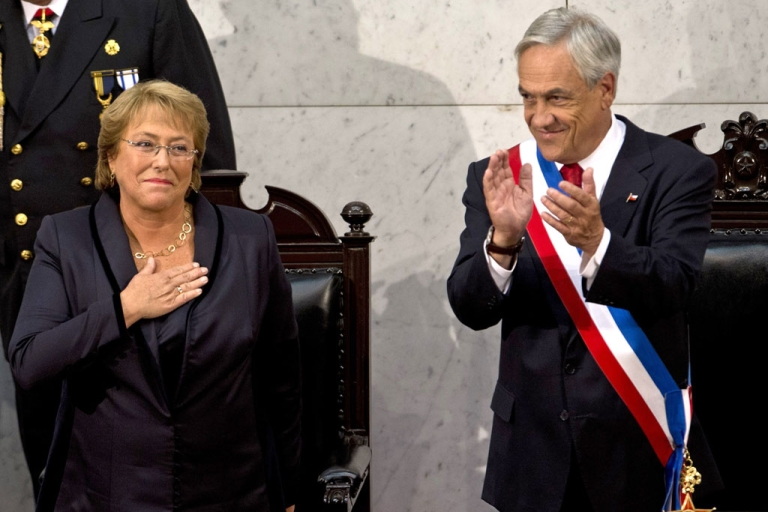 <p>Chilean new President Michelle Bachelet (L) is applauds by outgoing President Sebastian Pinera during her inauguration ceremony at the Congress in Valparaiso, Chile, on March 11, 2014.</p>