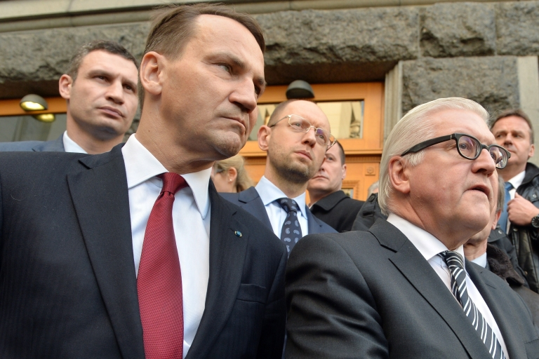 <p>Sikorski (L foreground) with German Foreign Minister Frank-Walter Steinmeier in front of Ukrainian opposition leaders in Kyiv after a deal was signed between the president and opposition last month.</p>