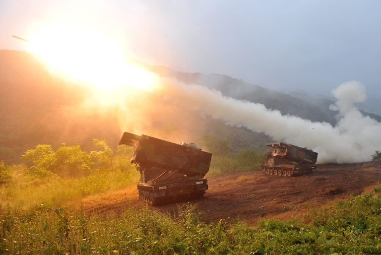 <p>A US Multiple Launch Rocket System fires rockets during a training exercise in the South Korean border county of Cheorwon on September 13, 2012. In apparent violation of UN resolutions, North Korea test fired two medium-range missiles today, according to Seoul. The annual US-South Korea military exercises are among the irritants that may have sparked the launch.</p>