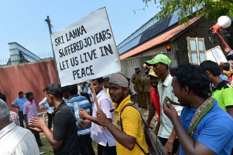<p>Sri Lankan Tamil pro-government activists take part in a demonstration outside the British High Commission in Colombo on March 20, 2014.</p>