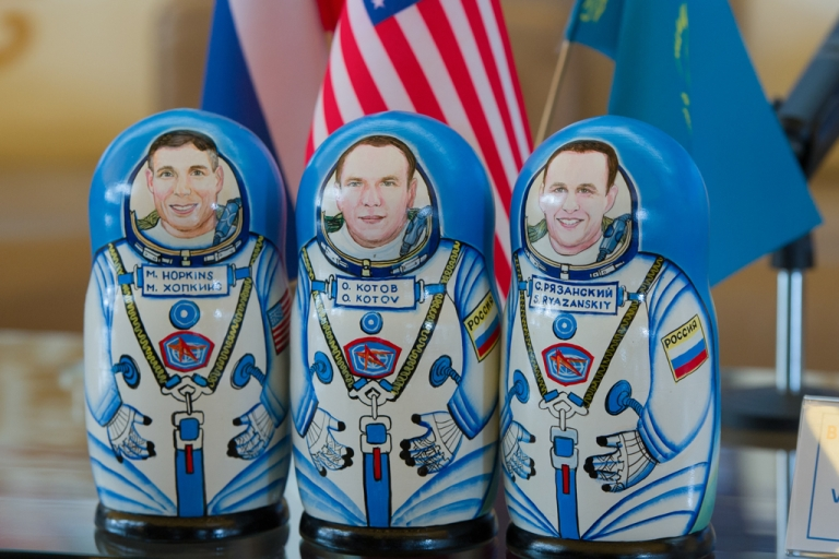 <p>March 11, 2014: A set of matryoshka dolls depicting the Expedition 38 crew, Flight Engineer Mike Hopkins of NASA, left, Commander Oleg Kotov of Russian Federal Space Agency, Roscosmos, center, and Flight Engineer Sergey Ryazanskiy are seen at a welcoming ceremony held at the Karaganda airport in Kazakhstan. The crew of three landed in their Soyuz TMA-10M spacecraft a few hours earlier near the town of Zhezkazgan, Kazakhstan after spending five and a half months onboard the International Space Station where they served as members of the Expedition 37 and 38 crews.</p>