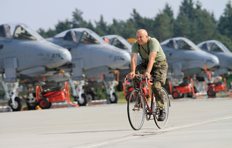 <p>A soldier rides past Air Force A-10 Thunderbolt airplanes, better known as