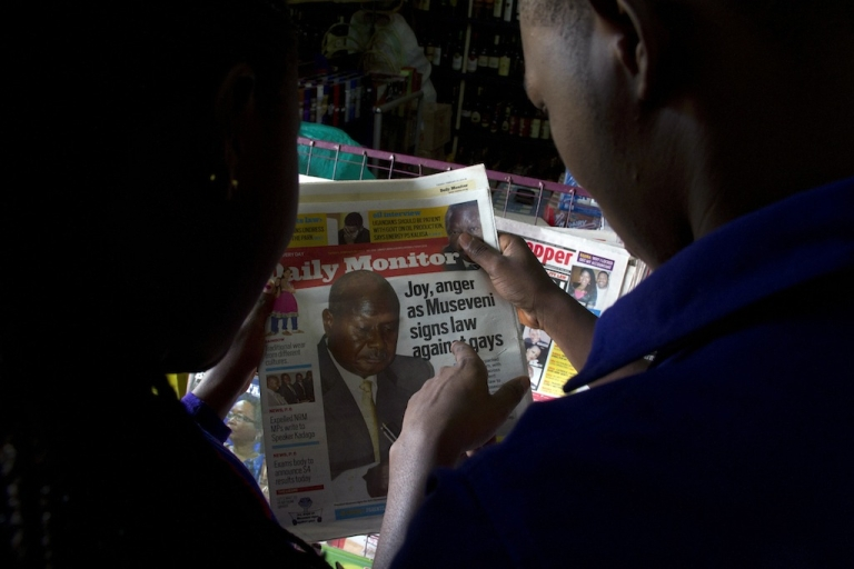 <p>People read Uganda's local dailies in Kampala on February 25, 2014.  On Monday, President Yoweri Museveni signed a bill into law which holds that repeat homosexuals should be jailed for life, outlaws the promotion of homosexuality and requires people to denounce gays.</p>
