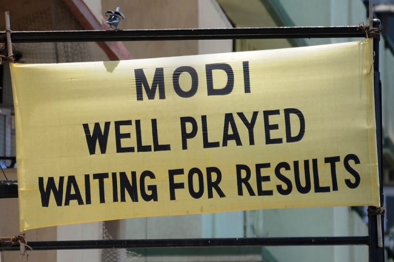 <p>A banner applauding Bharatiya Janata Party (BJP)'s prime ministerial candidate Narendra Modi at a busy intersection in Mumbai on May 13, 2014.</p>