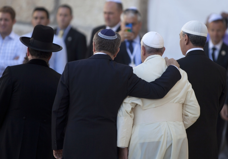 <p>Pope Francis and Rabbi Skorka, center, leave the Western Wall compound, with Omar Abboud at far right.</p>