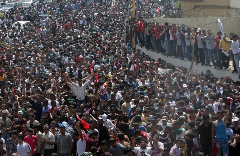 <p>Thousands of Syrian nationals living in Lebanon arrive outside the Syrian Embassy in Yarze east of Beirut to vote.</p>