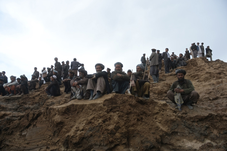 <p>Afghan villagers gather at the site of a landslide in the Argo district of Badakhshan province on May 3, 2014.</p>
