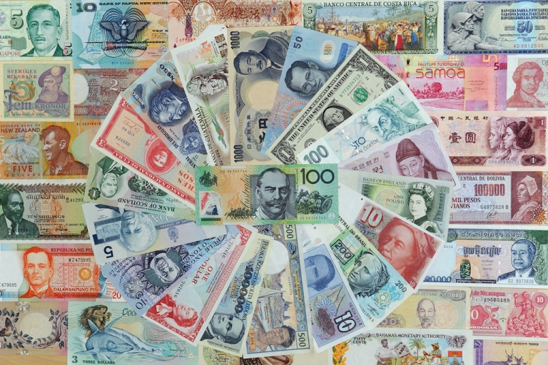 <p>A 100 Australian dollar note and other foreign currencies.</p>