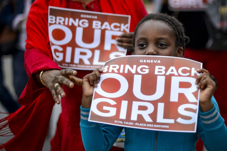 <p>A young participant shows a placard during a demonstration in Geneva for the release of the abducted Nigerian schoolgirls on May 10, 2014.</p>