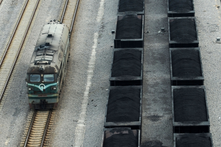 <p>This picture taken on March 5, 2014, shows freight cars filled with coal parked at a coal mining facility in Huaibei, in eastern China's Anhui province.</p>