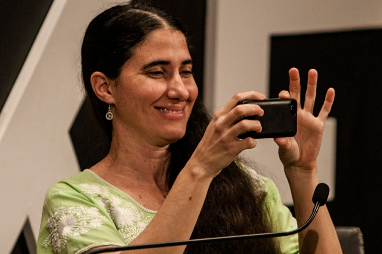 <p>Cuban blogger Yoani Sanchez takes a snapshot during a conference in Colombia on Jan. 31, 2014.</p>