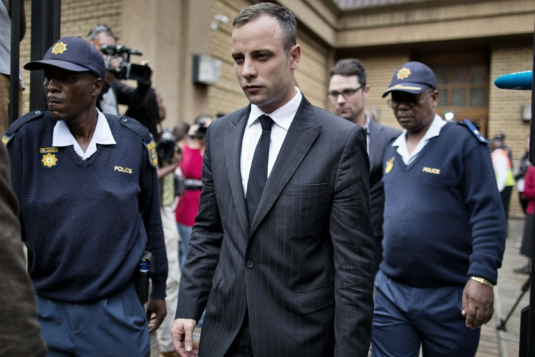 <p>Oscar Pistorius (C) leaves the North Gauteng High Court on April 16, 2014 in Pretoria.</p>