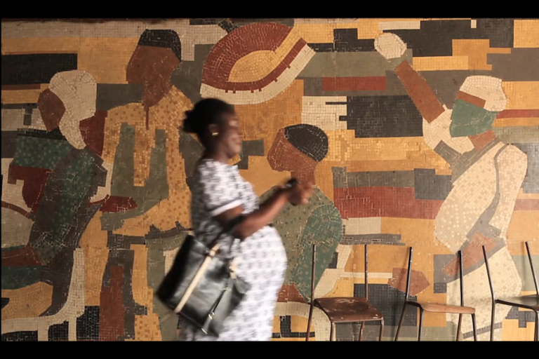 <p>A still image from Allison Shelley's video report on abortion in Nigeria shows a pregnant Nigeria woman leaving a clinic.</p>