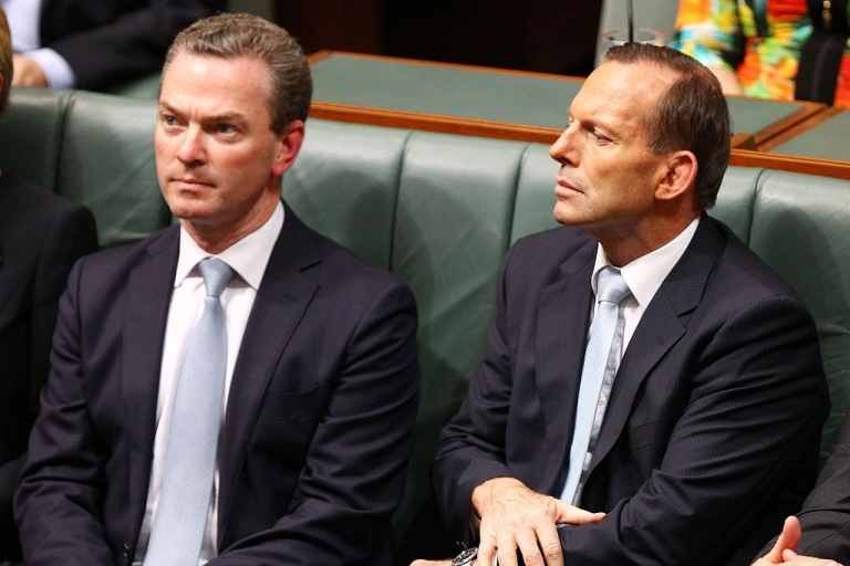 <p>Prime Minister Tony Abbott listens to Treasurer Joe Hockey deliver his first budget speech in the House of Representatives at Parliament House on May 13, 2014 in Canberra, Australia.</p>