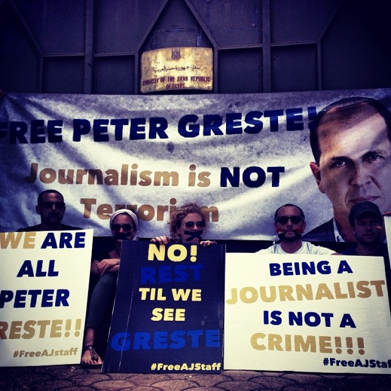 <p>Protesters at the demonstration over journalist's Peter Greste's detainment, outside the Egyptian embassy in Nairobi.</p>