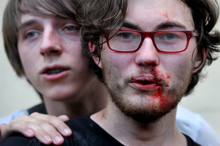 <p>June 29, 2013- A gay rights activist is seen after clashes with anti-gay demonstrators during a gay pride event in St. Petersburg. Russian police arrested dozens of people on Saturday after clashes erupted in the city of Saint Petersburg between pro- and anti-gay demonstrators.</p>
