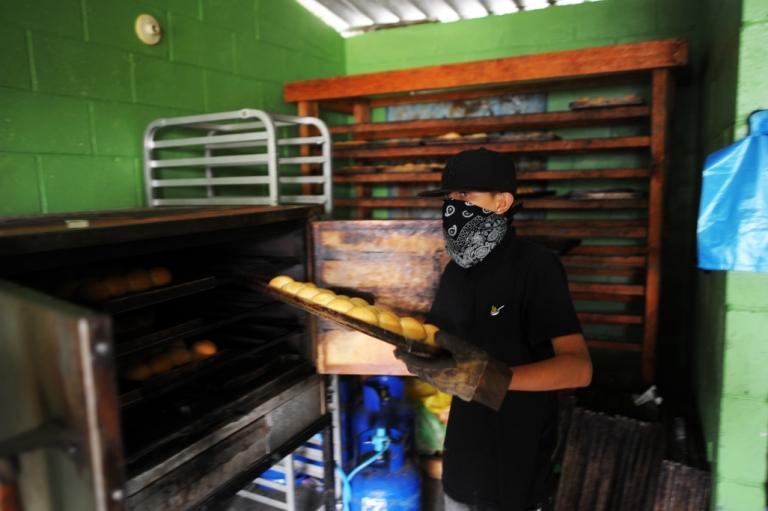 <p>A member of El Salvador's Barrio 18 gang prepares buns at a bakery in Ilopango, on the outskirts of San Salvador.</p>