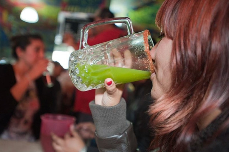 <p>Once the drink of only Mexican country folk and urban construction workers, pulque, the fermented nectar of the maguey cactus, has found acceptance today among students and hipsters. This Mexican student enjoys a glass of celery-flavored pulque.</p>