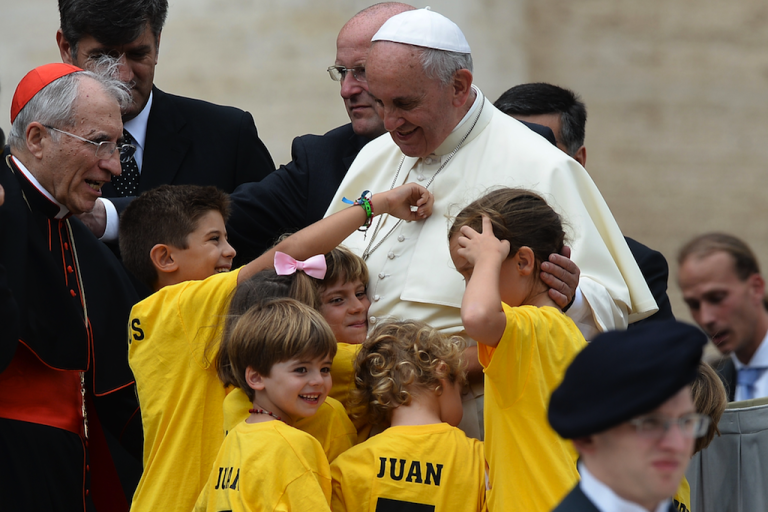 <p>Pope Francis greets children at the end of his general audience at St Peter's Square on June 25, 2014 at the Vatican.</p>